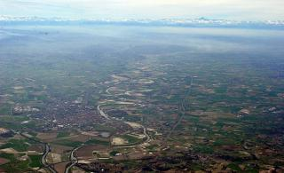 The valley of the river Tanaro in the North of Italy. In the distance the Alps and Monte Viso.