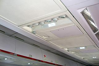 The panel above the passenger seats in the aircraft Tu-204 Red Wings airlines