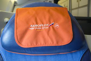 The Aeroflot logo on the headrest of the seat in the Boeing-777-300
