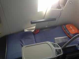 The unfolded chair-bed in business class of a Boeing 777-300 Aeroflot