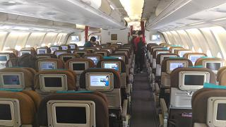 The passenger compartment of economy class in Airbus A330-300 of Garuda Indonesia