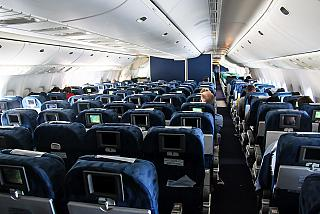 The tourist class cabin of a Boeing 777-200 Transaero