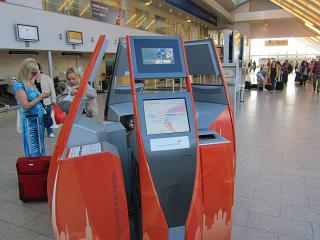 The departure lounge and self check-in kiosks at the airport of Tallinn
