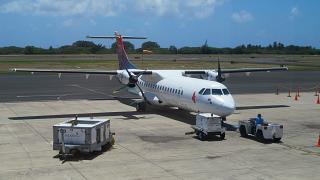 The plane ATR of 72 airlines Island Air at the airport in Lihue