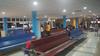 The waiting room before the boarding gate at the International airport of Seychelles