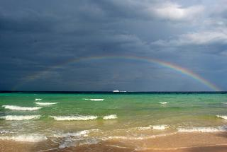 The evening sky and the rainbow over the Andaman sea
