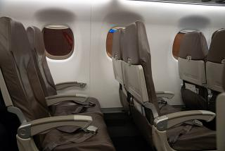 The passenger seats in the Embraer 190 of the airline Helvetic Airways