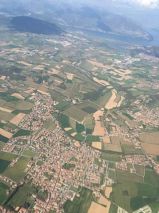 In flight over Italy after takeoff from Bergamo airport