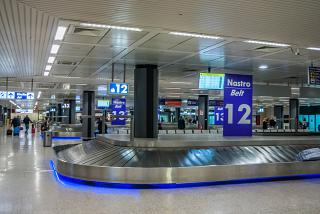 The baggage claim hall in terminal 1 of the airport Rome Fiumicino