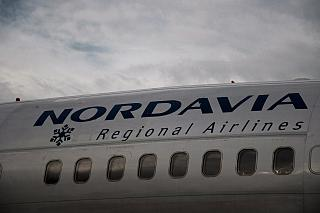 """Logo """"Nordavia"""" on Board the aircraft Boeing-737-500"""