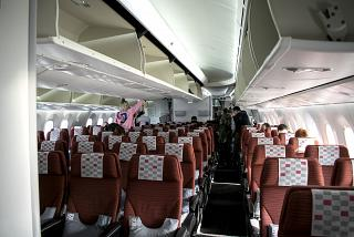 The passenger compartment of economy class in the Boeing-787-8 of airline JAL