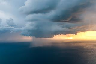 Thundercloud and rain over the sea