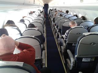 The cabin of the Embraer 190 of the airline Air Astana