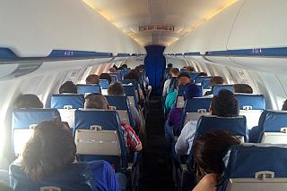 The cabin of the Bombardier CRJ100 airlines Rusline