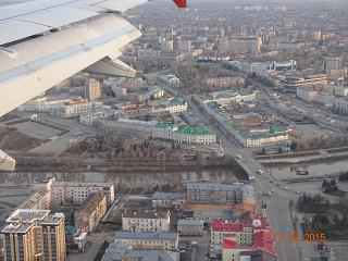 In flight over the centre of Omsk before landing at the airport