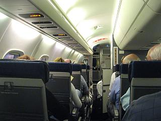 The passenger cabin of the Embraer ERJ140 airlines American Eagle
