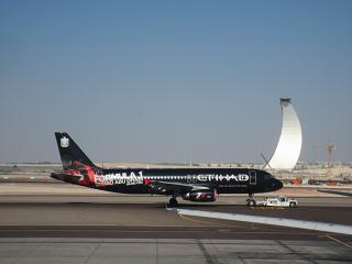 "Airbus A320 Etihad Airways in a special livery ""Formula 1"" in Abu Dhabi airport"