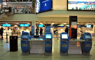 Self check-in kiosks in the terminal T1 of the airport Helsinki Vantaa