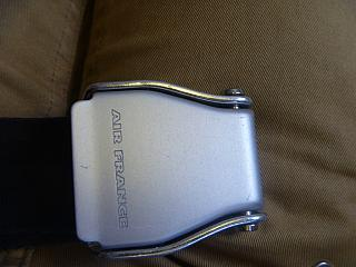 The seat belt buckle with the logo Air France