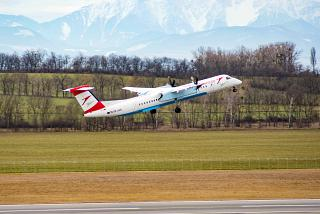 Takeoff of Bombardier Dash 8 Q400 of Austrian Airlines at Vienna airport