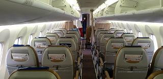 The passenger cabin of the Bombardier Dash 8 Q400 of the Aurora airline