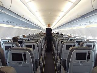 The cabin of the Airbus A319 of Alitalia