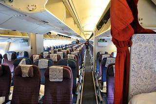 The passenger compartment of economy class in the Boeing-767-300 of the airline LATAM Brasil
