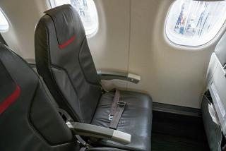 The passenger seat in the Embraer 190 of the airline TAP Express