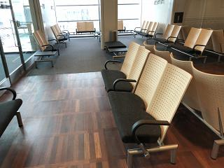 Seats for passengers at the gates in area F in terminal 2 of Copenhagen airport Kastrup