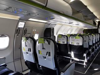 Economy class passenger cabin in the Airbus A321neo of S7 Airlines