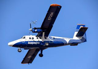 "In-flight DHC-6 Twin Otter of the airline ""Aurora"""