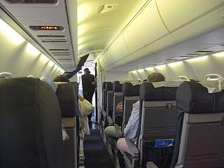 The cabin of the Embraer ERJ145 in the airline Dniproavia