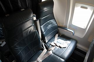 The passenger seats in the aircraft Bombardier CRJ100 airlines Rusline