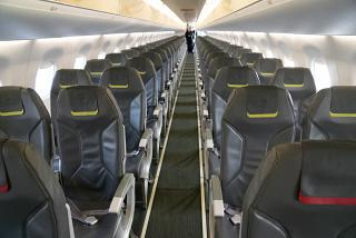 The passenger cabin of the Embraer 190 of the airline TAP Express
