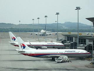 The Malaysia Airlines aircraft at the airport in Kuala Lumpur. In the foreground - Boeing-737-400.