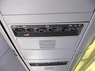 The panel above the passenger seat in the aircraft Boeing-737-300