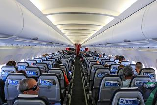 The passenger cabin of the Airbus A320 Aegean airlines