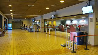 The check-in area of the airline Mokulele Airlines at Honolulu international airport