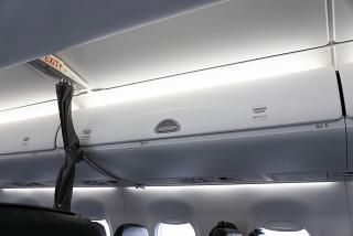 Luggage racks in the plane Embraer 190