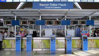 Self check-in kiosks in the main terminal of the airport of Kuala Lumpur