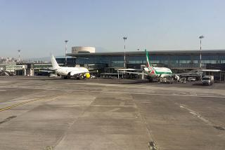 The planes at the passenger terminal of the airport Catania-Fontanarossa
