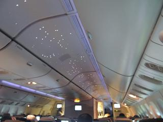 Lights in the starry sky in Boeing-777-300 Emirates airlines
