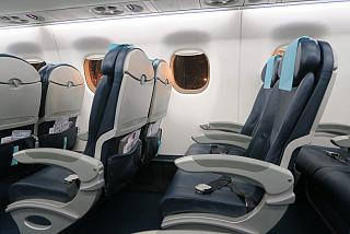 The passenger seats in the Embraer 190 of the airline AZAL