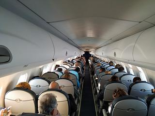 The passenger cabin of the Embraer 190 of Ukraine International Airlines
