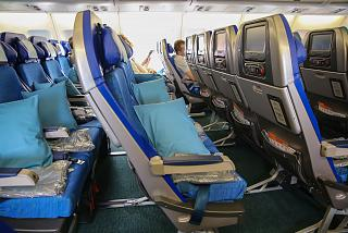 The passenger seats of economy class Airbus A340-300 airlines Cathay Pacific