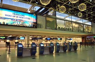 The check-in area in terminal T1 of the airport Helsinki Vantaa