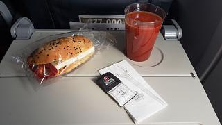 Sandwich with tomato juice on a flight of Turkish airlines
