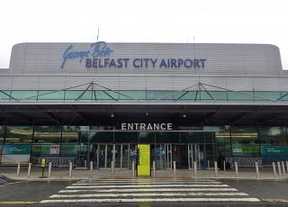The entrance to the passenger terminal of the airport Belfast city George best