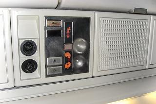 Individual panel above the passenger seat in the aircraft Fokker 100