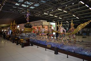 The sculptural composition is in a clean area of the airport is Bangkok Suvarnabhumi